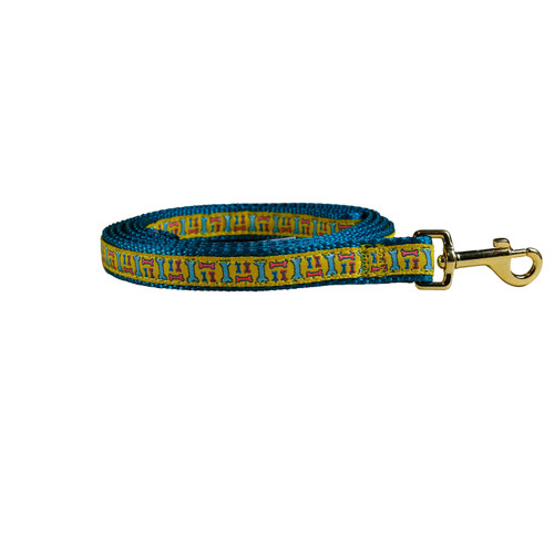 Dog leash with bones design in yellow in blue nylon backing