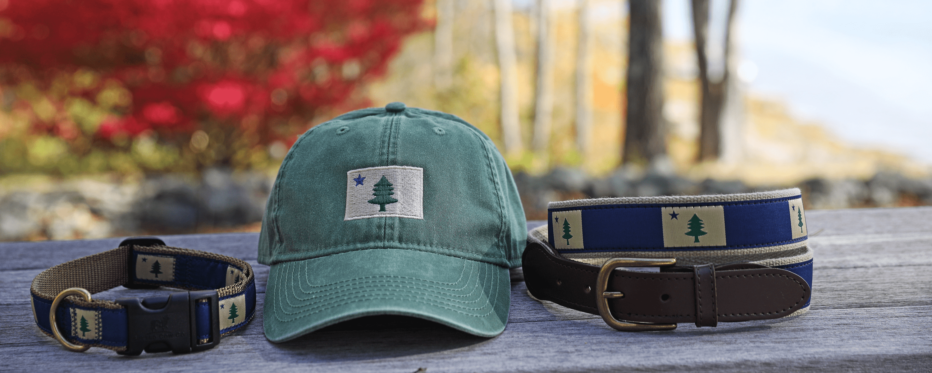Maine Hat and Belt on rock wall