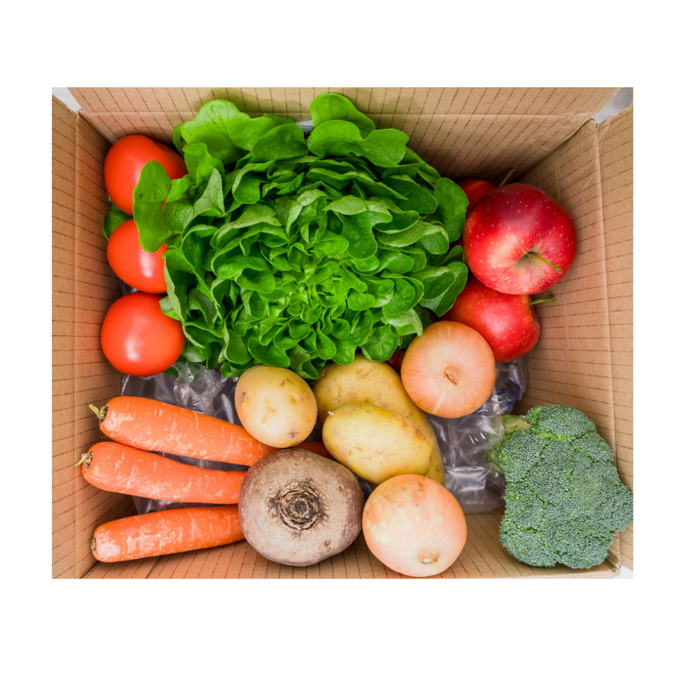 A selection of seasonal fruit and vegetables including potatoes, apples, citrus, bananas, tomatoes and avocado.