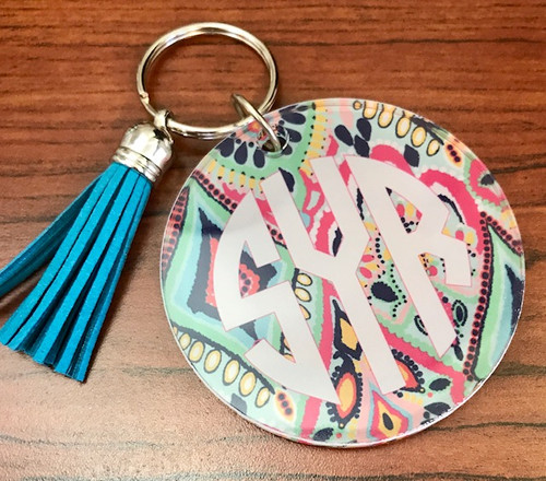 "Your favorite Lilly Inspired Print with your initials on a 3"" Round Shape ColorLyte® Acrylic Keychain Fob, 3"" x .22"", Clear coated. You can see the image clearly and vibrantly from both sides, with light enhancing the effect. Acrylic Key Fobs – Tested for durability!  Of course it's in top fashion with the added matching tassel!"