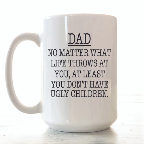 "MUG DETAILS ♥ 15 ounces ceramic white mug ♥ Mug says ""AT LEAST YOU DON'T HAVE UGLY CHILDREN  ♥ Text printed in BLACK & UP TO 5 NAMES ON OTHER SIDE OF MUG  ♥ Design professionally and permanently printed on the mug ♥ Hand-wash recommended to preserve the longevity of the printing ♥ Dishwasher safe (top rack only) & microwave safe ♥ Professionally sublimated in our Smithville, Tennessee workshop for the highest quality finish. ♥ Free Shipping on all orders. Ships within 3-7 business days. I try to be as quick as possible.  …………………………………….  We are committed to selling only the highest quality ceramic mugs in the industry, great for everyday use. The design is actually part of the mug. We don't use decals or vinyls for our mugs. We do a lot of customization, so if you have any specific ideas for a mug, just message us and we can make it happen together."