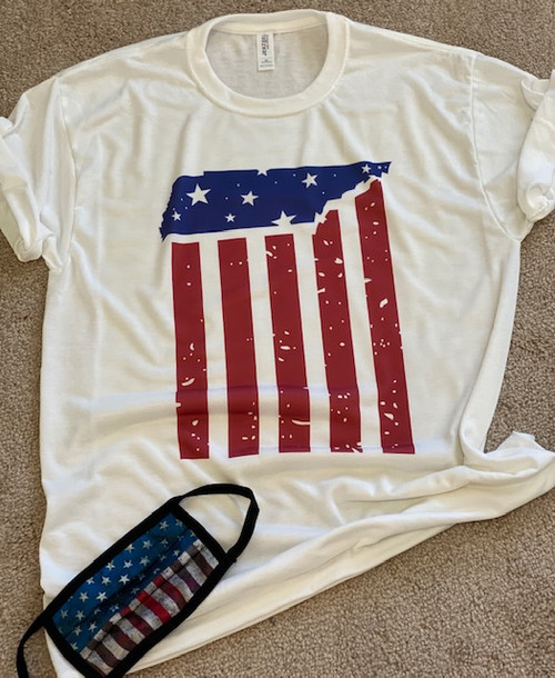 Just in time for the 4th of July, this brand new tee will let you show off your American pride! Featuring white lettering and two stars, this shirt is perfect for all of your backyard events and neighborhood block parties! The material is lightweight and so easy to throw on for an afternoon of relaxing! Just pair it with shorts and sandals before you head out - you'll be the star of every 4th of July party in this shirt!  This is a digitally imprinted and is printed on a white, silver, or heather gray shirt unisex tee sleeve shirt. These shirts are not fitted and run true to size.!