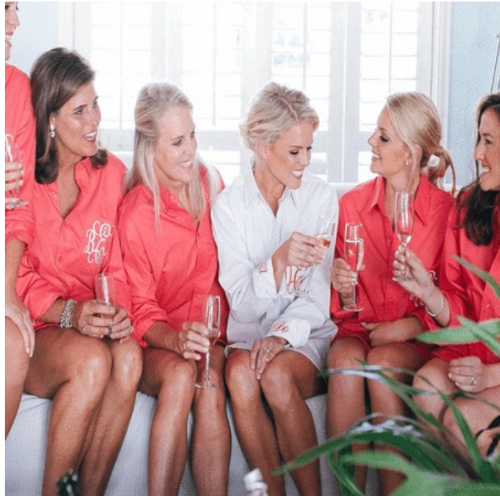 """Monogrammed Bridesmaids' Shirts Our Classic Button Down is the perfect Practical and Personal Bridal Party Gift. Adorned with Top Quality Embroidery, its Personal and Unique! Button Down Front eliminates the risk of Hair and Make Up mishaps on the Big day of getting ready. Not only are these Stylish and comfy on the wedding day, but they are cute and trendy with skinny Jeans on casual days, and great as a swim suit cover up on pool days. A super Unique and Personalized gift, perfect for Group Pictures, Necessary for """"getting ready"""", and Useful for everyday. It doesn't get much better than that...."""