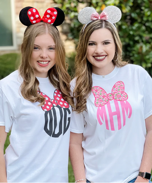 Dress your little one like her favorite princess with Disney monogrammed clothing. Visit Disneyland with clothes that match Mickey, Minnie, oy your favorite character. Look glamorous everyday with Disney monogrammed apparel for adult & kids. Turn your princess mode ON with Disney monogrammed clothing. Our collection of monogrammed items featuring Mickey Mouse, Minnie Mouse, & the Magical World of Disney is a year-round essential that can bring a smile to your face! Regardless of whether you are attending a school event or going to DisneyLand, nothing can look better than the enduring combination of Disney with your Monogram. We offer an exclusive collection of contains Lilly Pulitzer inspired patterned Minnie Mouse T-Shirt, Big Print & Left Chest Minnie/Mickey Design, Caffeine & Disney, plus many more. Our products are apt for those who are dreamy and have a unique imagination. They have a subtle balance of girlish aesthetics and a fun, festive style. These outfits are not just adorable, they are fashion-forward and attention seeking too. These Disney Monograms have the power to catch any individual's attention. Never Grow Up!