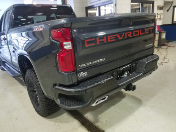 rear of grey 2019 Chevy Silverado Tailgate Stripes CHEVROLET Letters
