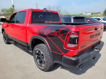 side angle of red 2020 Ram 1500 Rebel REB SIDE Graphics Stripes 2019-2021