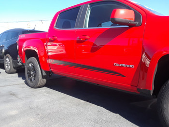 front of red Chevy Colorado Rocker Graphics RATON 2015-2020