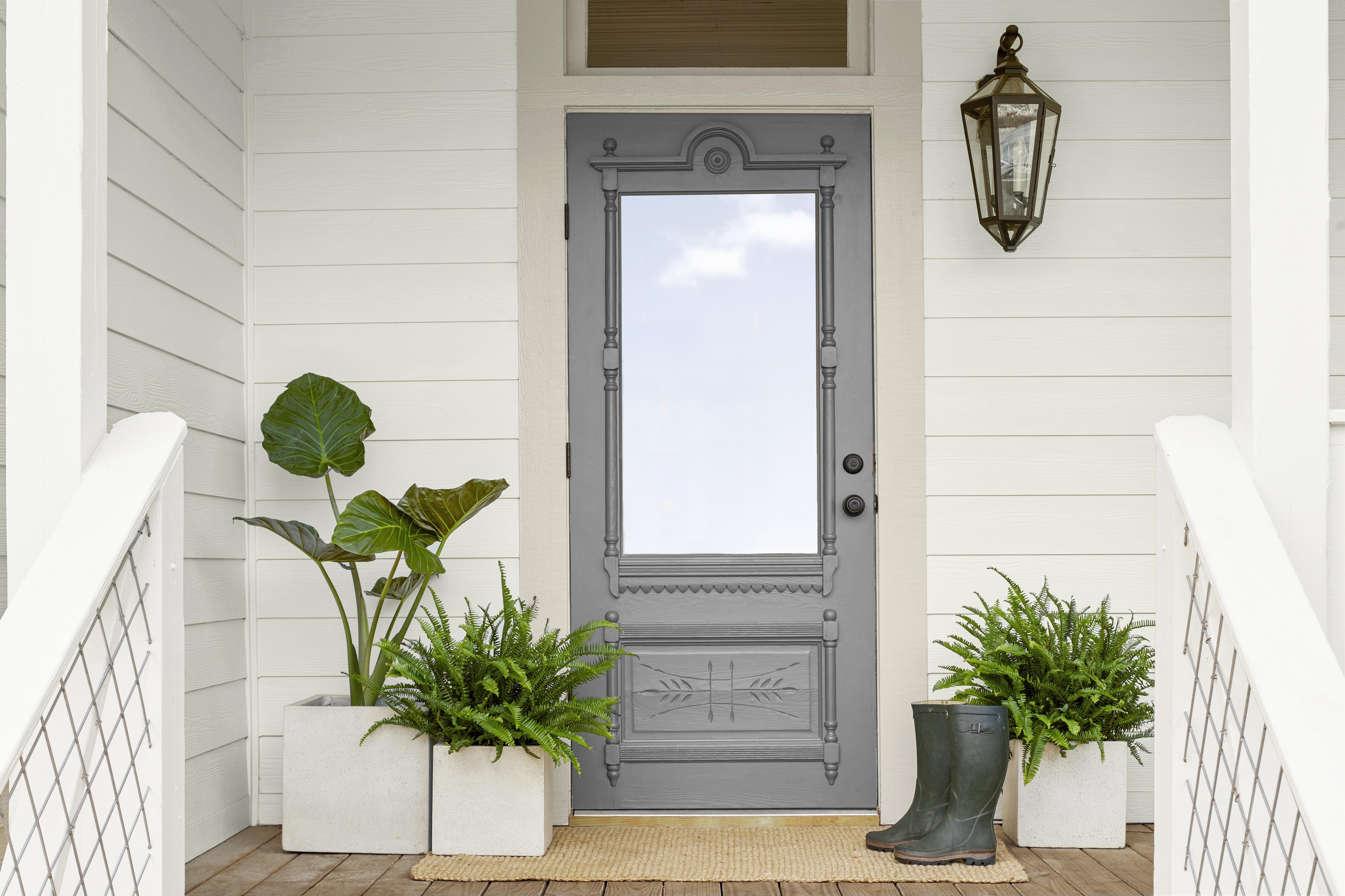 porch-with-grey-door-and-plants-hor.jpg