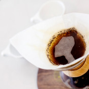 Bird's eye view of coffee brewing in Chemex with filter