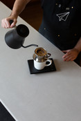 Barista using Fellow Stagg pourover kettle