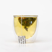 Pluck Tea – 'Movie Night' Green tea steeping in a glass