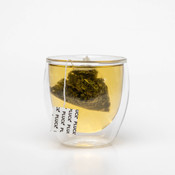 Pluck Tea – 'FIELDS OF GREEN' Certified Organic Green tea steeping in a glass