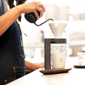 Barista pouring over Hario v60 with filter
