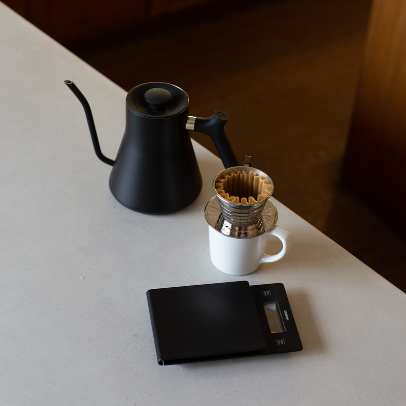 Pourover set up of  Fellow Stagg pourover electric kettle, Kalita wave dripper and filter, Hario timer and scale