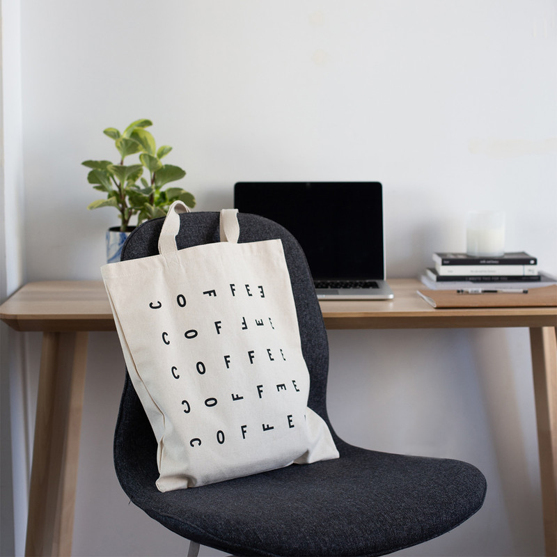 lifestyle shot of canvas tote bag on a chair