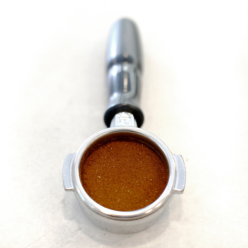 Coffee tamper with tamped coffee