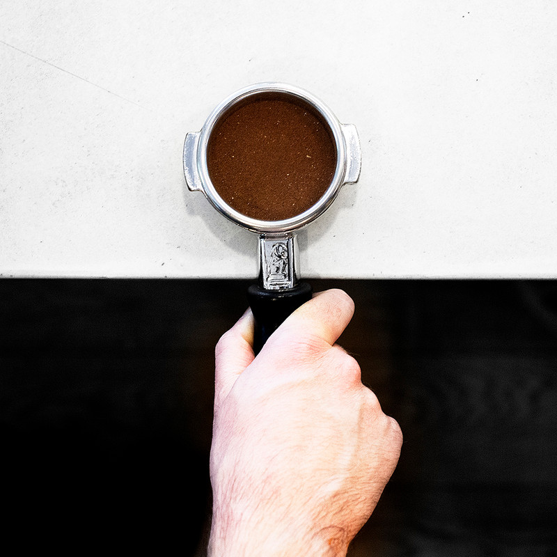 Coffee grinds in tamper
