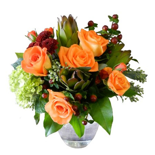 "This is a perfect gift of seasonal flowers.  Five Roses are accented by Hydrangea, Spray Roses, Hypericum, Safari Sunset, Seeded Eucalyptus, and Fall Mums.  12"" wide by 16"" tall"