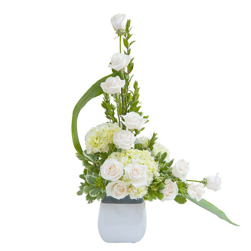 This Elegant Love Tribute really captures the pure elegance of this all white modern design. It pairs well with Elegant Love Casket Spray and our Elegant Wreath.