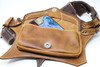 El Milagro Leather Utility Belt Bag with iPhone in it.