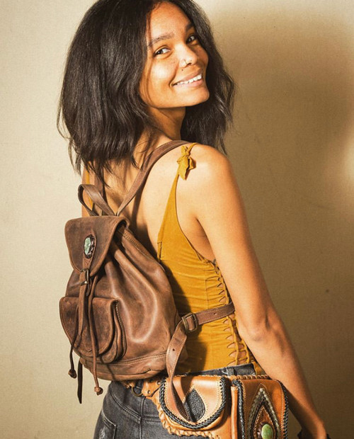 Green Stone & Leather Backpack Lifestyle Shot With Model