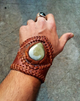 Lifestyle photo of leather cuff