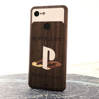 PlayStation inlay design in ebony, ash, bamboo and walnut