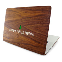 Custom engraved Toast MacBook cover in walnut with colored film and inlayed wood.