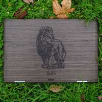 Custom engraved HP Envy X360 laptop cover in ebony with lion engraving.