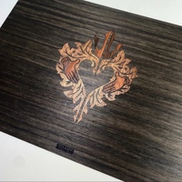 Heart design on an ebony wood Surface Book cover. Walnut and rosewood inlays.