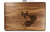 Custom wood MacBook laptop cover in walnut with fox engraving.