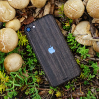 Toast wood iPhone SE (2nd gen) cover in ebony, lifestyle with mushrooms.