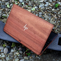 Toast HP Spectre wood cover in lyptus with laser cutout HP logo reveal.