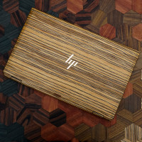 Toast HP Spectre wood cover in zebrawood.