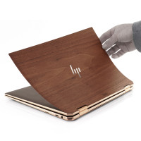 Installation of the top cover for HP Spectre wood skin.