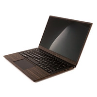 """Detail shot of Toast's Dell XPS 13"""" 7390 in ebony wood with optional screen and trackpad surround."""