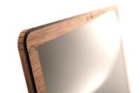 Surface screen surround in walnut.