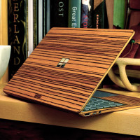 Toast wood cover for Surface Laptop Go in zebrawood, lifestyle.