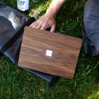 Toast wood cover for Surface Laptop Go in walnut, lifestyle.