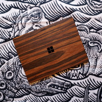 Toast wood cover for Surface Laptop Go in rosewood, lifestyle.