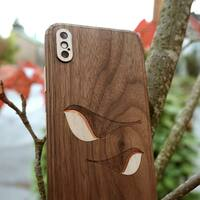 iPhone X cover in walnut with birds design.