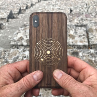 iPhone X cover in walnut with solar design.