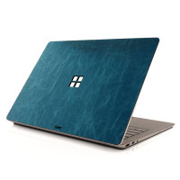Toast leather cover for Surface Laptop, in Bluetini aqua leather.