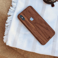 Toast iPhone X wood cover in walnut, lifestyle.