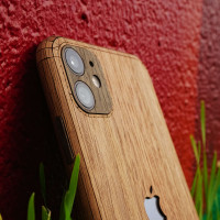 Toast iPhone 11 Pro wood cover in walnut, close-up.
