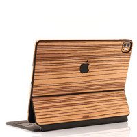 Toast wood cover for Magic Keyboard in zebrawood.