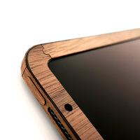 Toast wood screen surround for iPad in walnut.