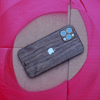 Toast wood cover to Apple iPhone 12 Pro in walnut.