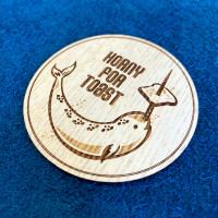 Toast real wood narwhal sticker in ash, side detail.