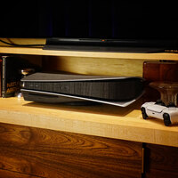 Toast wood cover for Sony PS5 in ebony, lifestyle.